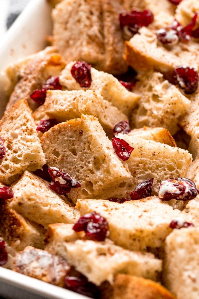 Festive baked gingerbread french toast casserole with cranberries is soft on the inside and crispy outside. The best holiday breakfast on Christmas morning. | aheadofthyme.com
