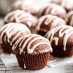 Festive gingerbread muffins with vanilla bean glaze are light, airy and fluffy with warm fragrant festive spices and rich molasses. A perfect holiday treat. | aheadofthyme.com