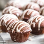 This fun twist on the classic takes hard, boring gingerbread and turns it into a delightful gingerbread muffins with vanilla bean glaze. Pure magic! | aheadofthyme.com