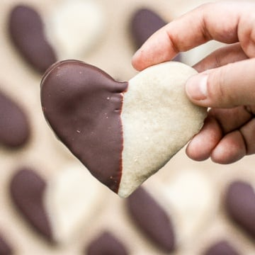Celebrate love this Valentine's Day with adorable chocolate-dipped shortbread heart cookies for your hunny. Try and just have one! | aheadofthyme.com