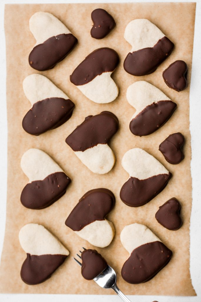Celebrate love this Valentine's Day with adorable chocolate-dipped shortbread heart cookies for your hunny. Try and just have one. | aheadofthyme.com