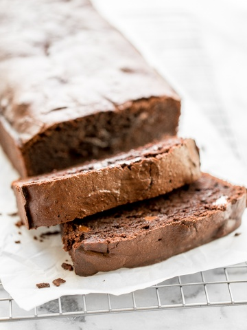 Double chocolate loaf cake is rich, intensely flavored, and a total show stopper this Valentine's Day. It is dense and chewy, but it tastes like fudge! | aheadofthyme.com