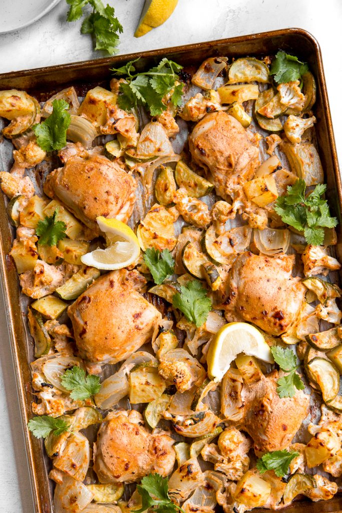 In under 30 minutes, create intensely flavourful tandoori chicken sheet pan dinner loaded with vegetables, any night of the week! Good-bye takeout! | aheadofthyme.com