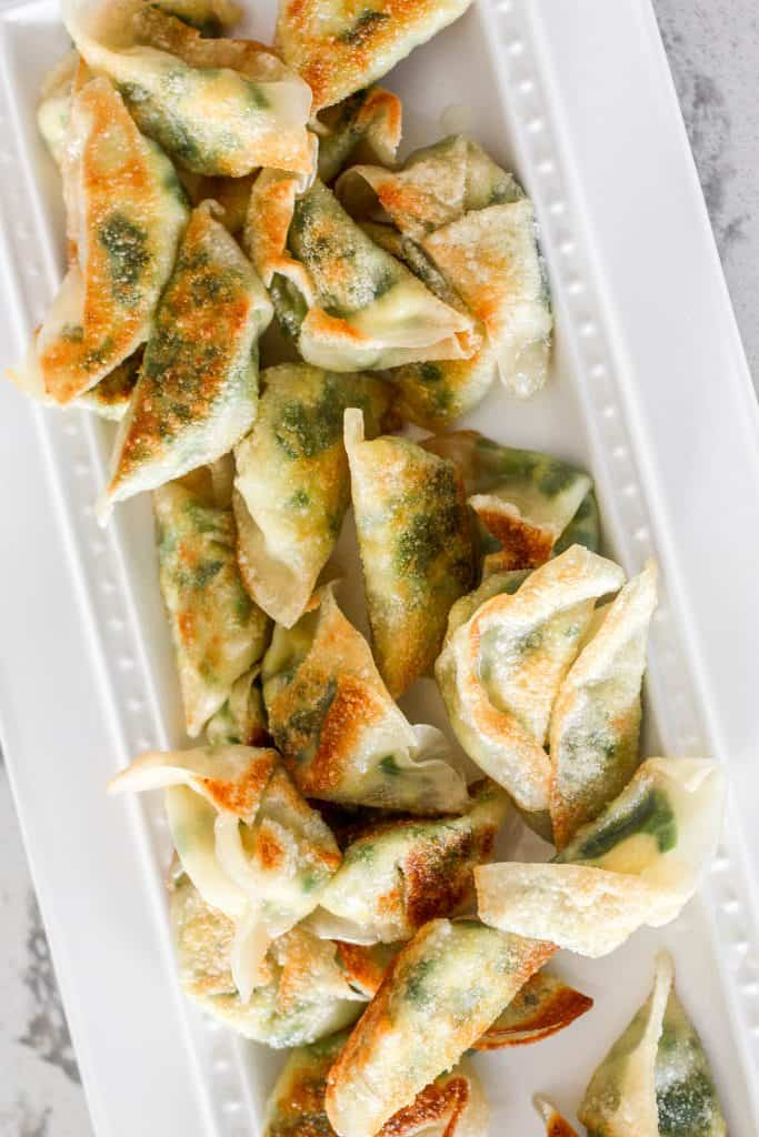 Fragrant chives with fluffy scrambled eggs, and a dash of flavour come together to create the perfect appetizer -- egg and chive vegetarian dumplings.   aheadofthyme.com