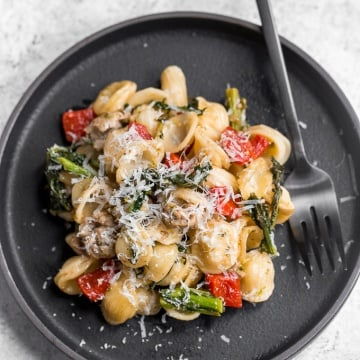 Orecchiette pasta with sausage, broccoli rabe, and roasted red peppers is a mix of spicy, sweet, and crunchy, and is on the table in less than 30 minutes! | aheadofthyme.com