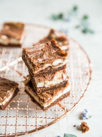 Caramel cheesecake brownies are totally indulgent and worth the effort, so toss that prepared brownie mix away and bake this with a few easy ingredients! | aheadofthyme.com