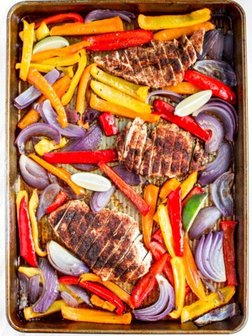 Sizzling and hot sheet pan chicken fajitas are on the table in less than 30 minutes! The best part is that you just throw everything into one sheet pan! | aheadofthyme.com