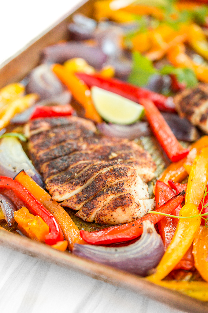 Sizzling and hot sheet pan chicken fajitas are on the table in less than 30 minutes! The best part is that you just throw everything into one sheet pan!   aheadofthyme.com