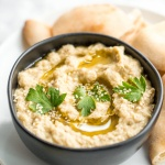 Baba ganoush is a creamy, roasted eggplant dip mixed with garlic and tahini for an explosion of flavor! It is perfect served with pita chips or veggies. | aheadofthyme.com