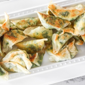 Fragrant chives with fluffy scrambled eggs, and a dash of flavour come together to create the perfect appetizer -- egg and chive vegetarian dumplings. | aheadofthyme.com