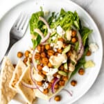 Mediterranean chickpea wedge salad combines chickpeas, crunchy vegetable toppings, and hummus dressing for a delicious deconstructed falafel flavour. | aheadofthyme.com