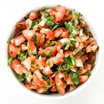 Easy 5-minute pico de gallo chunky salsa is packed with fresh tomatoes, onion, cilantro, and lime juice (and optional jalapeños for a spicy kick). | aheadofthyme.com