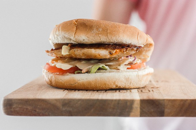 This 15-minute fish burgers with creamy slaw is juicy, flakey, and packed with flavour. So easy that it's the perfect summer weeknight meal! | aheadofthyme.com