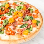 Spinach Tomato and Prosciutto Pizza