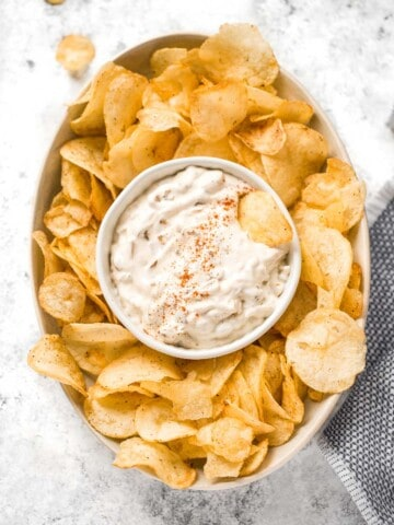 Caramelized onion dip is creamy, flavorful, and melt-in-your-mouth delicious. This easy appetizer is perfect for entertaining, on game day, or for a snack.   aheadofthyme.com