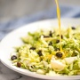 Brussels sprouts salad with warm lemon anchovy vinaigrette is pungent, but in the best possible way! A total explosion of flavours and perfect for a light, filling meal!| aheadofthyme.com