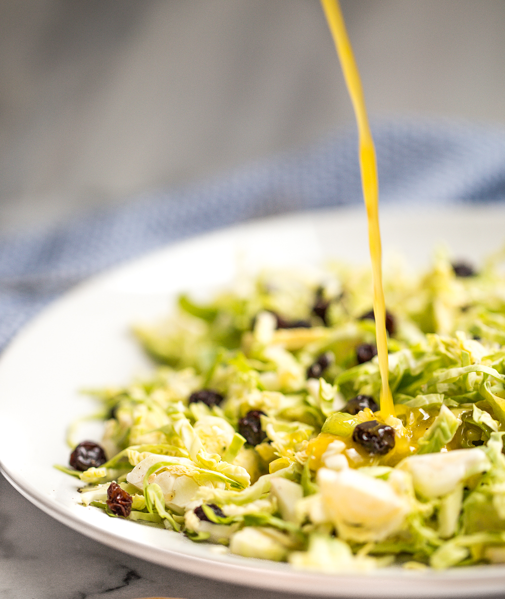 Brussels sprouts salad with warm lemon anchovy vinaigrette is pungent, but in the best possible way! A total explosion of flavours and perfect for a light, filling meal! | aheadofthyme.com