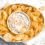 Caramelized onion dip is an easy, flavourful appetizer that literally melts in your mouth. It's sweet, caramely and even gets a kick from a secret ingredient. Try this crowd pleaser today! | aheadofthyme.com