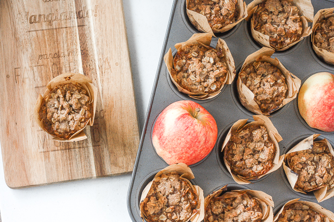 Spiced apple oatmeal muffins with crumb topping are packed with fresh apples, fall spices, and oats, to make the perfect breakfast, lunch or snack! | aheadofthyme.com