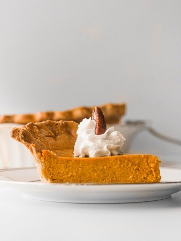 Thanksgiving just isn't the same without a slice of classic Thanksgiving pumpkin pie with flaky crust, smooth pumpkin filling, and topped with whipped cream and pecans.   aheadofthyme.com