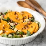 Quick and easy, fall harvest salad with roasted butternut squash and pomegranate with homemade apple cider vinaigrette is the perfect addition to your holiday menu. | aheadofthyme.com