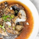Flaky, oily, and tender air fryer cod with black bean sauce is bursting with flavour and takes less than 20 minutes to make. The perfect weeknight dinner. | aheadofthyme.com