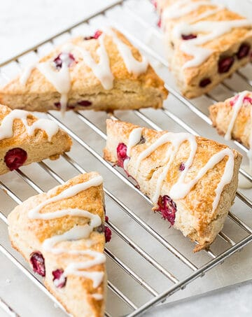 A light, tender and flakey cranberry scone, drizzled with a sweet orange glaze is the perfect winter breakfast.   aheadofthyme.com