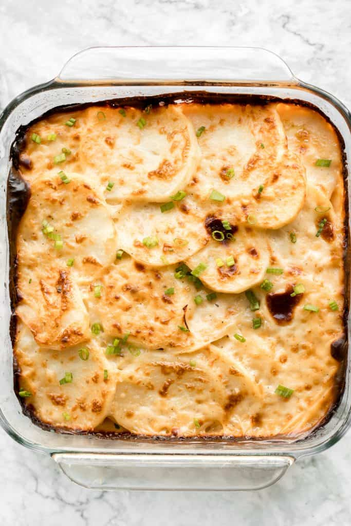 Rich and creamy potatoes au gratin is the ultimate comfort food made with sliced potatoes, cheese, and milk. It's the perfect side dish for the holidays. | aheadofthyme.com