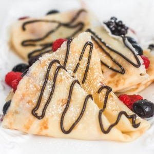 Light, thin, and buttery Nutella crepes with berries is an easy to make blender recipe that will have you craving breakfast all day! | aheadofthyme.com