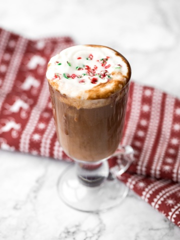 Make yourself a festive holiday drink in 5 minutes by combining creamy milk, chocolate, and minty candy canes for a cup of easy peppermint hot chocolate.   aheadofthyme.com