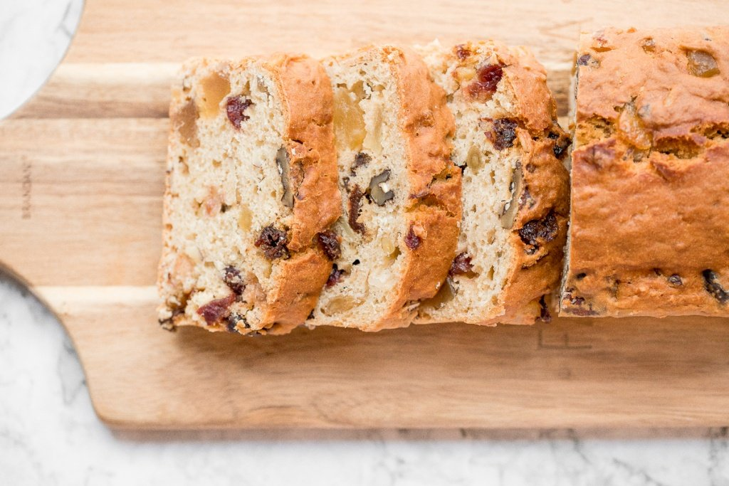 Perfect for the holidays, this super moist and tender, festive yogurt fruitcake is loaded with dried fruits and nuts for a burst of flavour in every bite. | aheadofthyme.com