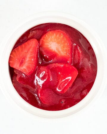 Easy to make, 3-ingredient homemade strawberry sauce is the perfect topping for all your dessert dishes. Pour this over pancakes, waffles, crepes, cheesecakes and more! | aheadofthyme.com