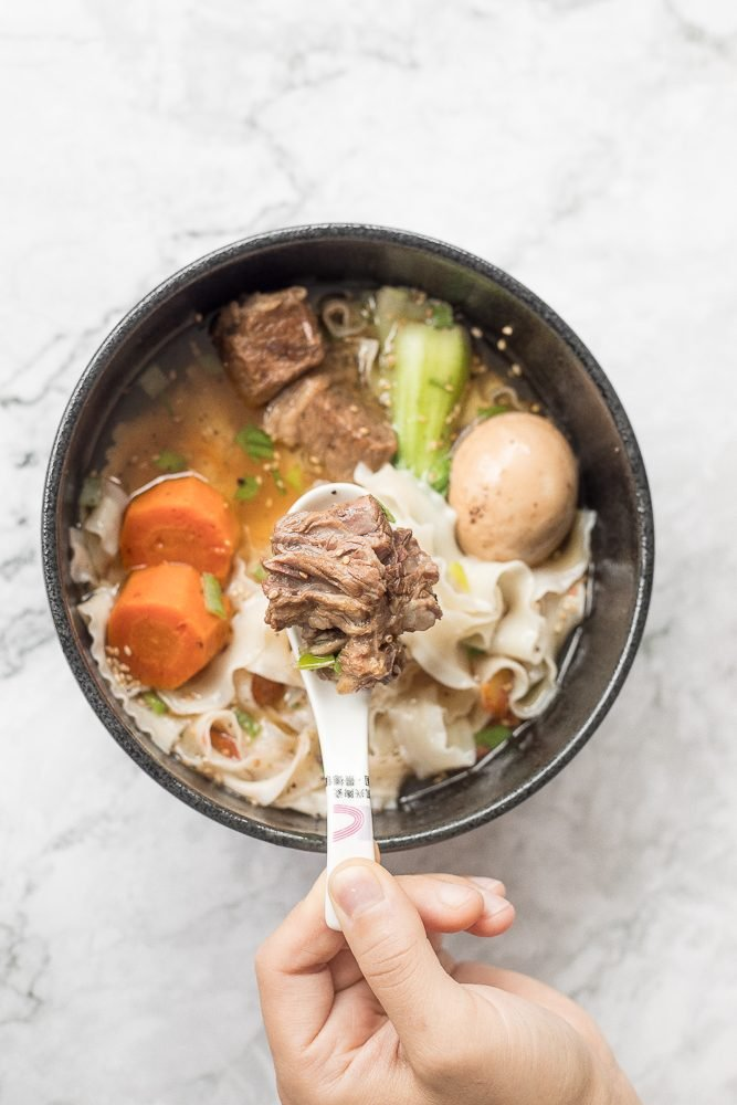 An easy weeknight dinner option, this hearty and oily slow cooker Asian beef noodle soup is packed with beef chunks, vegetables, noodles, and Asian spices and flavours. | aheadofthyme.com