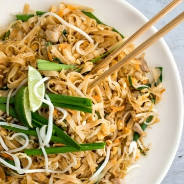 No more takeout when you can make flavourful, restaurant-style, authentic chicken Pad Thai at home in just 10 minutes. It's sweet, savoury, sour and nutty. | aheadofthyme.com