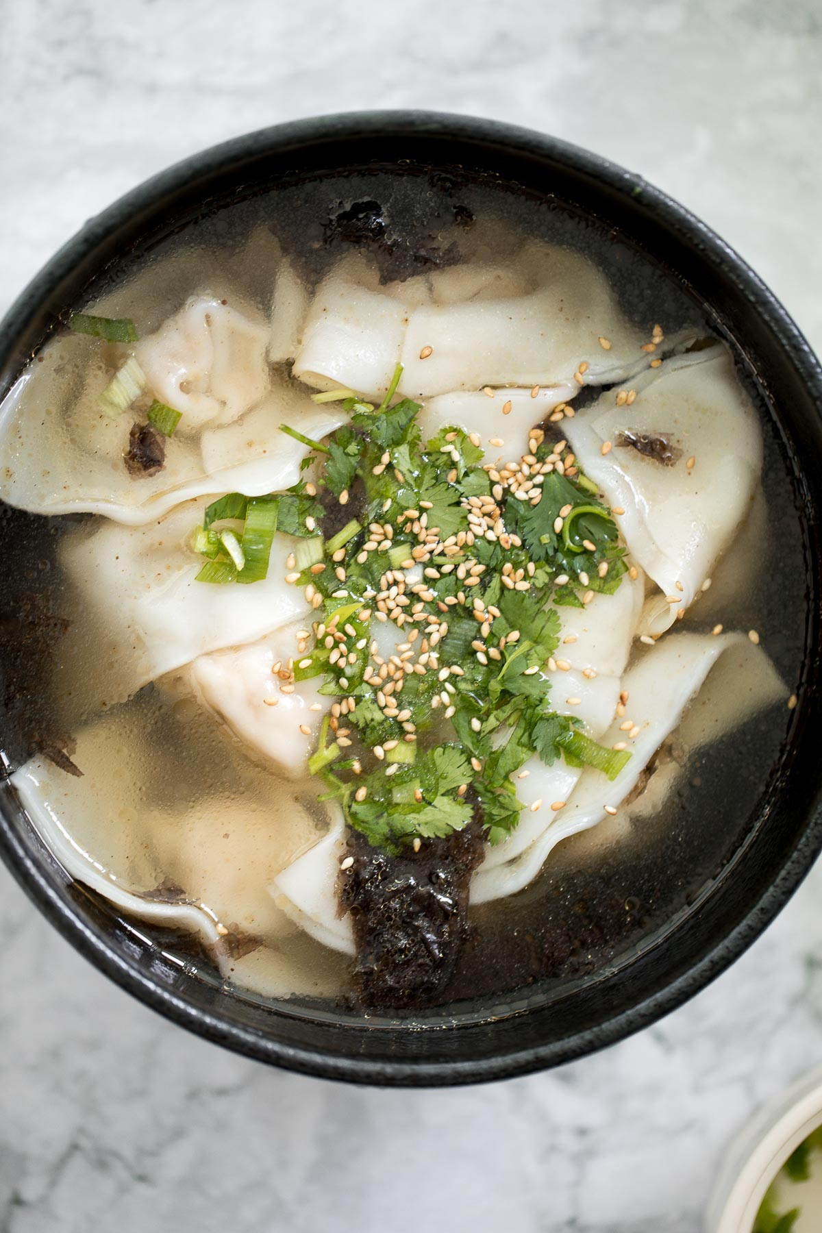 This easy, better than take-out, 10-minute Shanghai style wonton soup is the perfect soup to make for one person and is packed with classic Asian flavours. | aheadofthyme.com