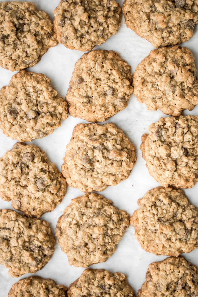 Grab a tall glass of milk and start dipping the best homemade, soft-centered, chewy chocolate chip oatmeal cookies you will ever try!   aheadofthyme.com