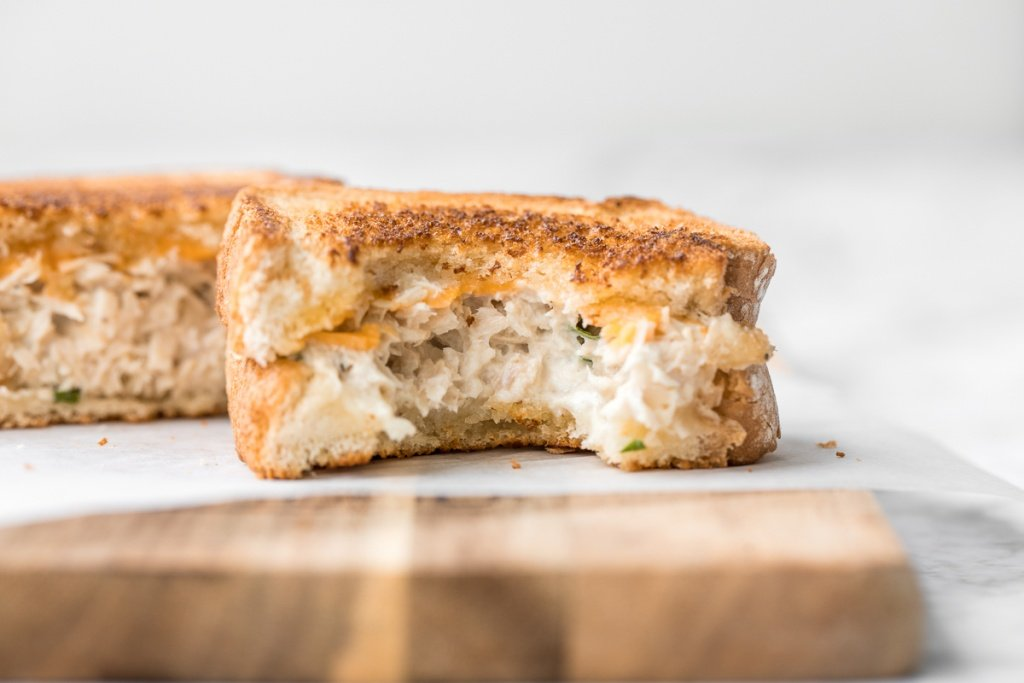 Get your hands on pantry staple canned tuna and make a delicious, crunchy tuna melt grilled cheese sandwich in less than 10 minutes! It's so tasty and easy! | aheadofthyme.com