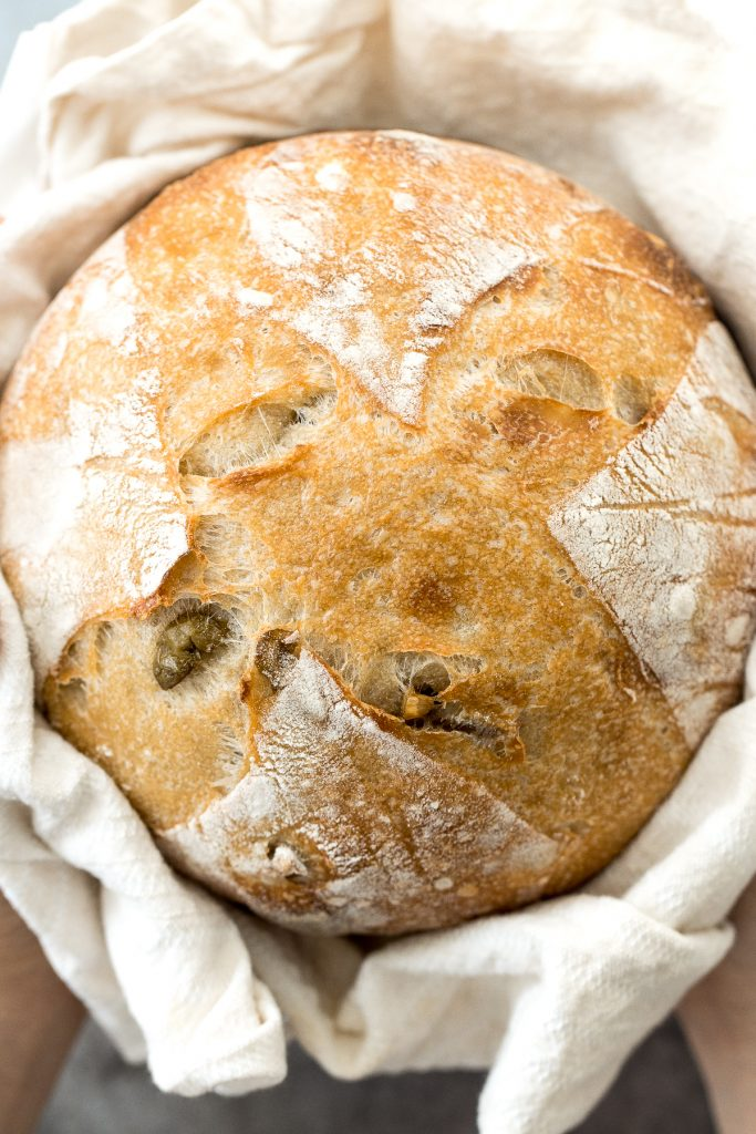 Artisan green olive sourdough bread is airy and chewy, has a signature crispy crust, and is loaded with tangy green olives for a Mediterranean flair. | aheadofthyme.com