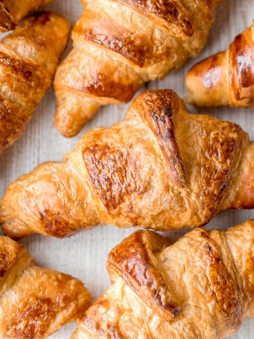 Quick and easy butter croissants are flaky, buttery, airy, and authentic, and are made in the fraction of the time using a special simplified technique. | aheadofthyme.com