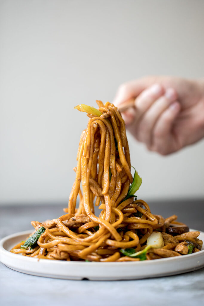 Better than take-out, flavourful and authentic Shanghai fried noodles with chicken, mushrooms, and bok choy is made in just 10 minutes - the easiest dinner!   aheadofthyme.com