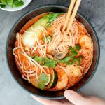 This gluten-free, one pot Thai red curry noodle soup is so flavourful and packed with shrimp, vermicelli rice noodles, fresh herbs, lime juice + fish sauce. | aheadofthyme.com