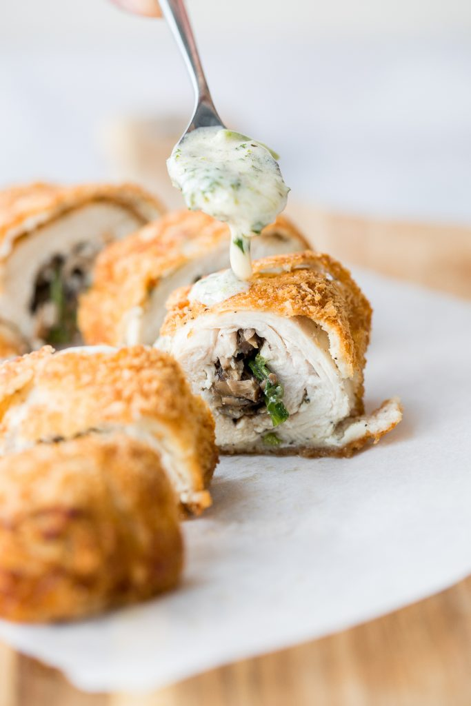 Give your chicken breasts an upgrade by stuffing them to make fancy, juicy chicken roulade with spinach and mushrooms topped with a creamy alfredo sauce. | aheadofthyme.com