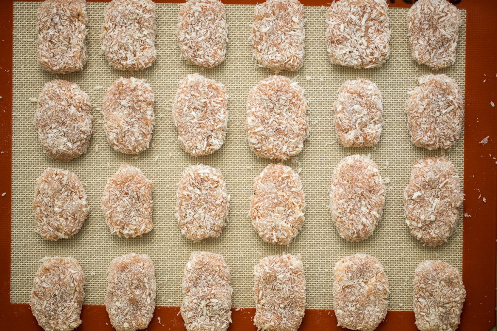 Easy homemade chicken nuggets with chicken breast are golden and crisp on the outside and juicy and tender inside. They're freezer-friendly so make extra.   aheadofthyme.com