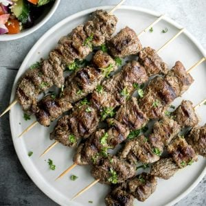 Quick and easy, grilled Greek lamb souvlaki skewers are marinated in a simple Mediterranean marinade for just 30 minutes. Serve with some tzatziki sauce. | aheadofthyme.com