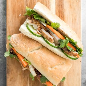 This easy-to-make, light and crunchy Vietnamese lemongrass chicken banh mi sandwich is packed with tender chicken, pickled vegetables and fresh herbs. | aheadofthyme.com