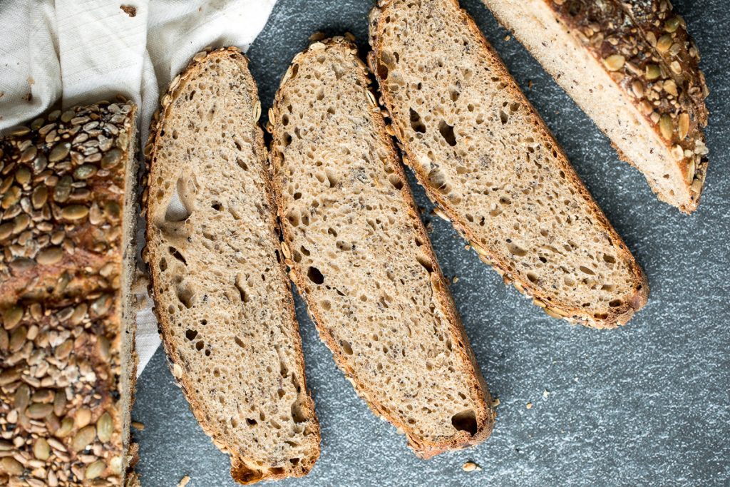 Small batch multi-seeded whole wheat sourdough bread is airy and chewy, is loaded with seeds inside, and has a signature crispy crust coated in more seeds. | aheadofthyme.com