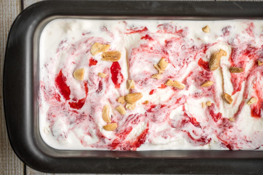 Smooth and creamy no churn vanilla ice cream with strawberry jam + toasted peanuts is easy to make, no ice cream maker required and better than storebought. | aheadofthyme.com