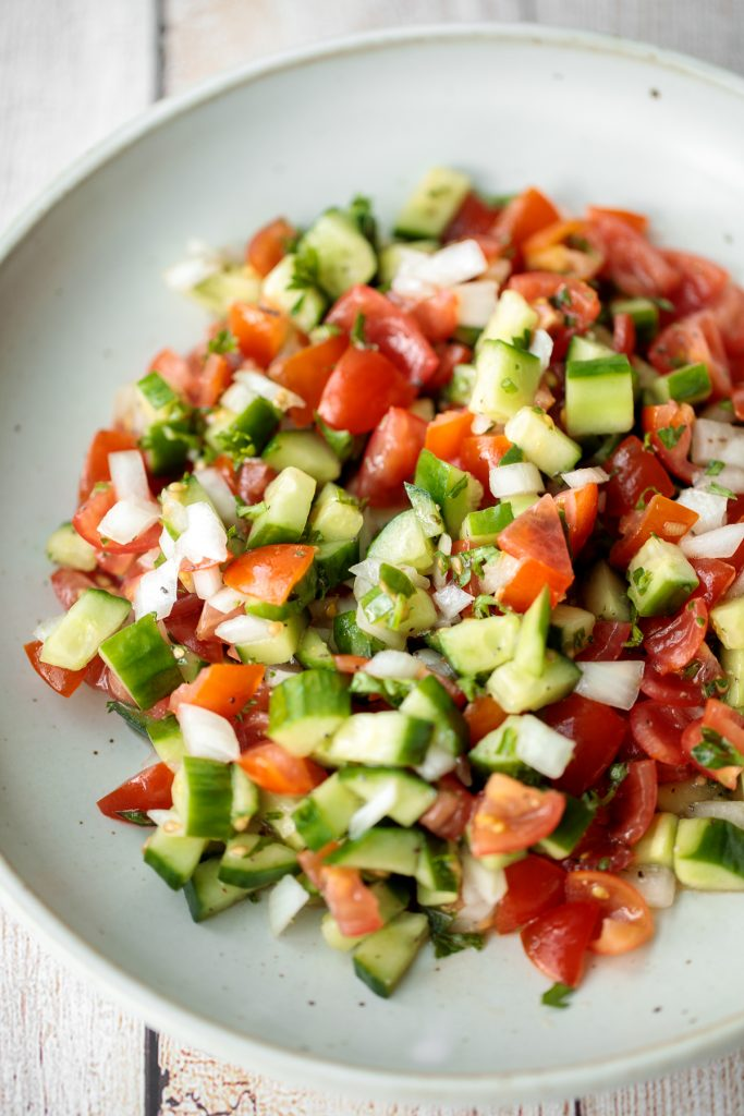 Healthy, light and refreshing Persian Shirazi salad with cucumber and tomato is a simple salad packed with herbs and tossed in an olive oil and lime dressing. | aheadofthyme.com