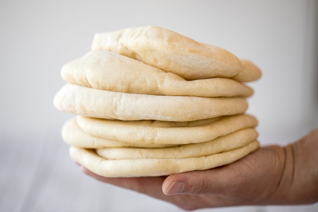 Nothing compares to freshly baked, quick and easy homemade pita bread. It's soft and puffy, with a perfect pocket. It takes just 15 minutes of actual prep. | aheadofthyme.com