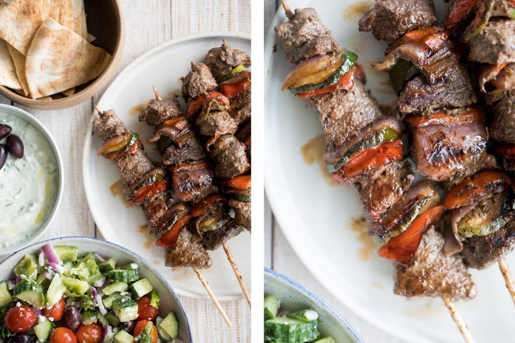 Easy Greek souvlaki beef shish kebabs are marinated in a garlicky lemony olive oil marinade and threaded with fresh vegetables. Cook on the grill or oven. | aheadofthyme.com